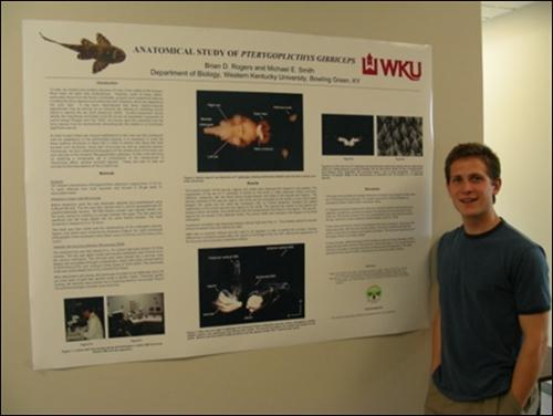 Brian Rogers at the BSURE (Biology Summer Undergraduate Research Experiences) poster session