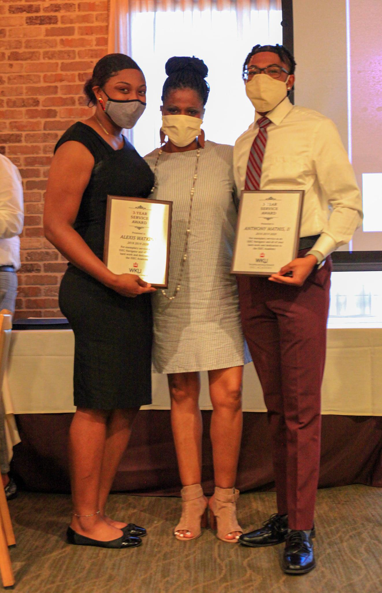 Three-year service award presented to Anthony Mathis & Alexis Watkins