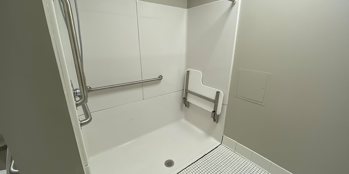 ADA accessible shower stall in the private bathroom in Normal Hall