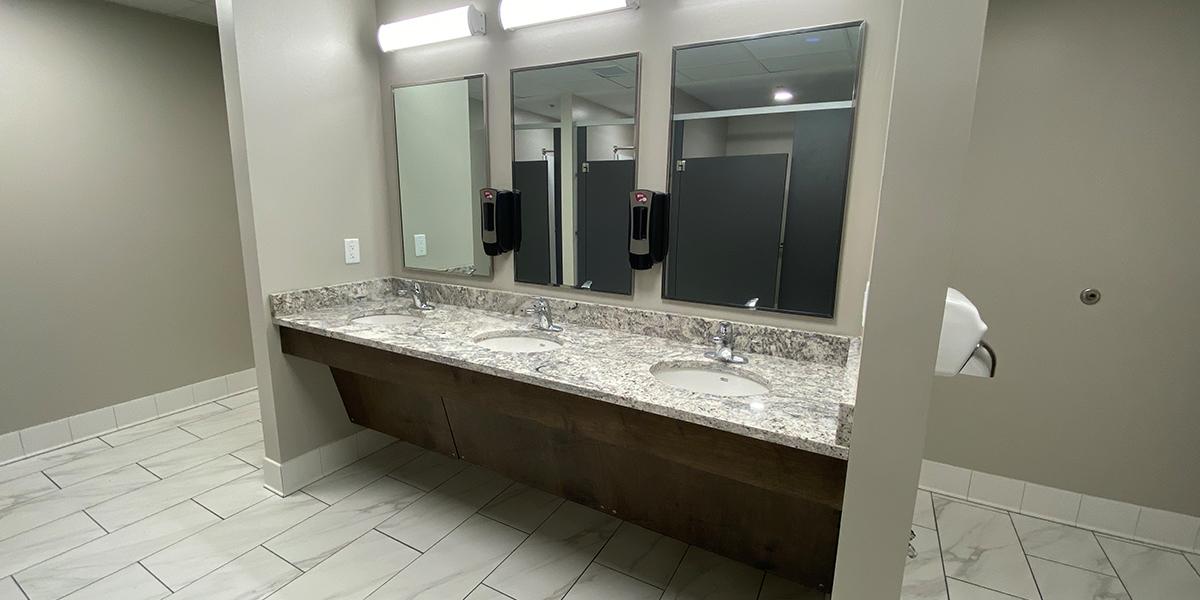 Three sinks inside the Normal Hall community bathroom