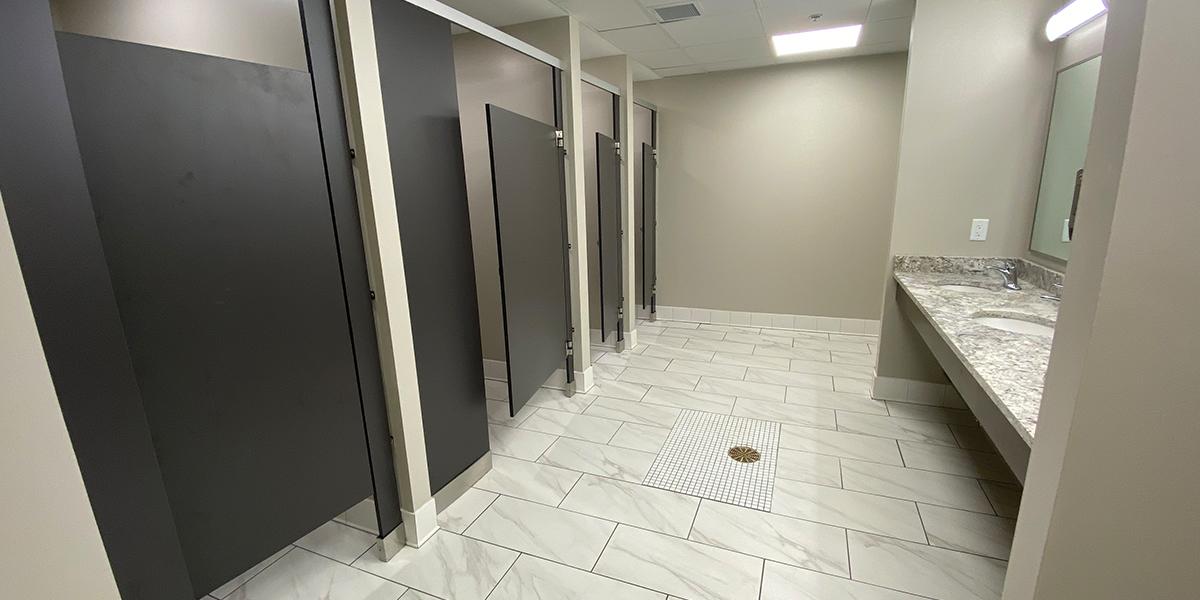 Community bathroom stalls and vanity