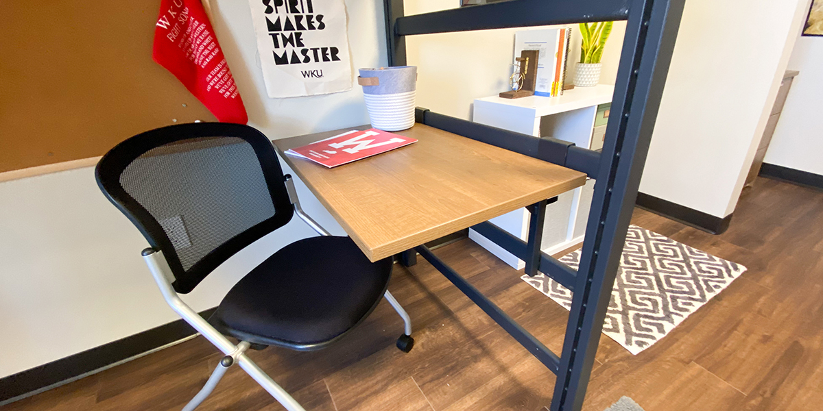 Floating desk and chair on casters