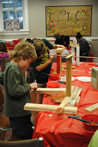 Campers building with wood.