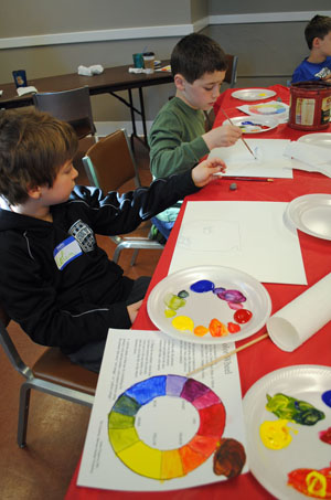 Mixing primary colors to make a color wheel.
