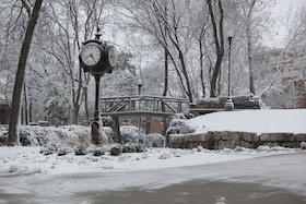 Clock behind Van Meter at Kissing Bridge
