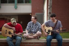 Students playing guitars outside of DSU