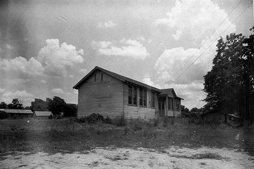 Built in 1936 and electrically lit, the two-room school shown here replaced the original schoolhouse. Schoolteachers between 1909 and 1922 included: G.L. Board (1909-13); A.M Todd (1914); Carrie Baily (1915-19); Cora Tribble (1920); and, J.P. Smith (1921-22). (Courtesy of Library Special Collections, WKU)