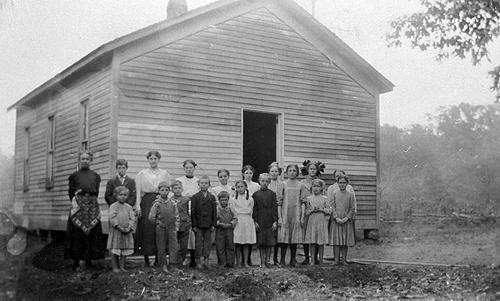 Walnut, oak and chestnut trees shaded the aptly named school of Shady Grove. Though the students used a painted plank as a blackboard, the school had a library which housed sixty volumes. (Courtesy of Library Special Collections, WKU)