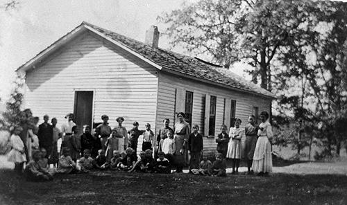 Located 23 miles from Bowling Green, the frame schoolhouse was heated in the winter with a coal stove and cooled in warmer weather with an abundance of oak trees surrounding the house. (Courtesy of Library Special Collections, WKU)