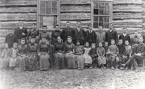 Teacher T. J. (Tandy) Gardner at the Richardsville log schoolhouse is shown seated with his students. Among this group are: Johnnie Whallen, Amanda Belle Richards (Ayles), Charlie Miller, Alford Hill, Eliza Miller, Etta Langford, Minnie Glenn, Addison Miller, Charles Frances, Susie Cherry, Adelia Cherry, Della Richards (Brownfield), Stella Speck, Alpha Richard, and Jessie Richards. (Courtesy of Library Special Collections, WKU)