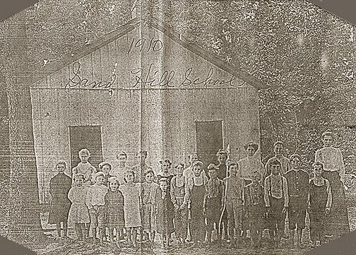 In 1910 students and teachers at Sand Hill School included: (front row) Mona Garett, Elva Miller, Ida Floyd, Mattie Glass, Stella Wilson, Shellie Beck, Elvis Glass, Gilbert Grimes, Johnnie Simmons, Roy Floyd, Guy Simmons, Walker Wilson, Adam Wilson and Geneva Bratcher, and (second row) Tiny Grimes, Ruthie Wilson, Martha Grimes, Daisy Simmons, Lettie Flora, May Miller, Hattie Floyd, Bertha Grimes, Bessie Miller, Charlie Miller and Nettie Wilson, teacher. (Courtesy of Library Special Collections, WKU)