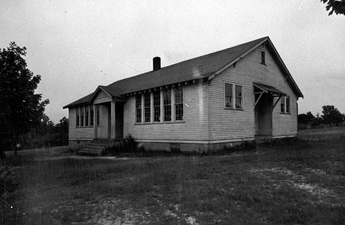 "The Sand Hill School, built in 1928, was a four-room schoolhouse with no electricity. It's September 3, 1928 opening began with the singing of ""America"" followed by several sacred songs, Scripture reading and the Lord's Prayer. By 1932-33, Sand Hill offered a three-year course of study in high school work. (Courtesy of Library Special Collections, WKU)"