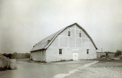 Before the Richardsville gymnasium was finished, athletes played basketball on an outside court. Built in 1936, the gymnasium had no electricity until 1940. Prior to this time, dynamos (generators) were used to power the building. The gym had a box platform stage on the first floor. It's basement contained a brick forge, anvil, woodworking bench, electric saw, and emery wheel. (Courtesy of Library Special Collections, WKU)