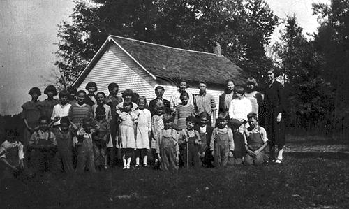 Students at Cedar Valley School carried water from a spring to the schoolhouse. It's library contained twelve volumes. (Courtesy of Library Special Collections, WKU)