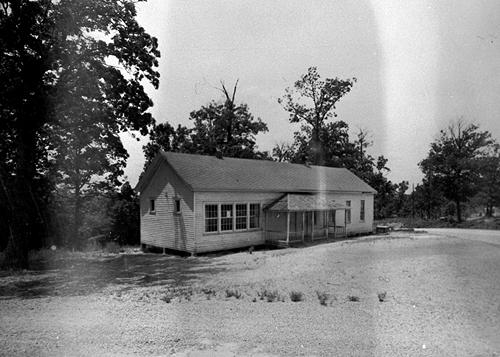 A new Indian Creek School was constructed in 1916 with an addition added in 1936. The two-room school was naturally lit and located in northern Warren County. Improvements made by the teacher and pupils in 1924 included painting the blackboard and the house's interior and setting out roses. (Courtesy of Library Special Collections, WKU)
