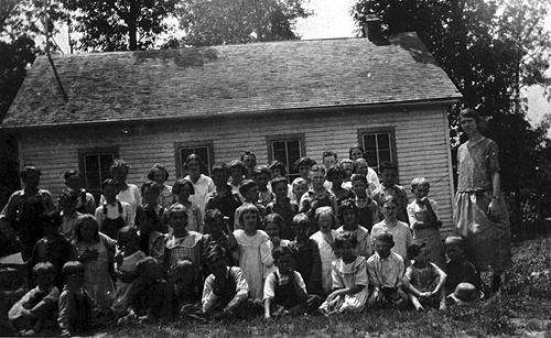 The Mt. Pleasant Church of Christ log meetinghouse served as a schoolhouse for area children as early as 1865. Students moved from the log building to a new frame schoolhouse when it was built about 1900. (Courtesy of Library Special Collections, WKU)