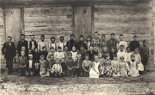 Bridgeport School's log house was built ca. 1890 with students still being schooled in the facility in 1924. The school's teacher, Emery White (far left), later served as Warren County Superintendent of Schools. (Courtesy of Library Special Collections, WKU)
