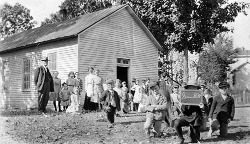 Green Hill School students obtained their water from a cistern. In 1924, the school's teacher bought a flag to improve the school. (Courtesy of Library Special Collections, WKU)