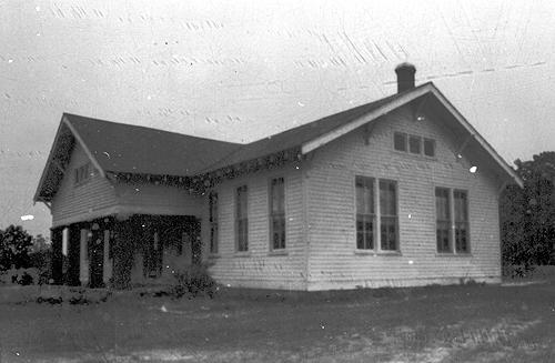 Built in 1923, the Bays Fork two-room schoolhouse was lit with glass bowl kerosene lamps set into swinging brackets. A Gray & Dudley coal stove heated the facility. (Courtesy of Library Special Collections, WKU)