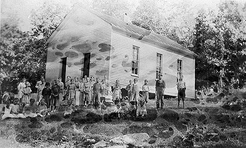 Sulphur Springs heated its frame schoolhouse with a wood stove. It's library contained 200 volumes. Improvements made in 1924 included a croquet set for the playground. (Courtesy of Library Special Collections, WKU)