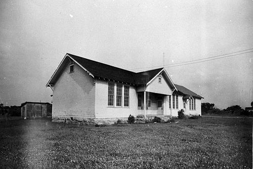 Delafield's new four-room schoolhouse was electrically lit. This school burned and was replaced during World War II by another frame structure. (Courtesy of Library Special Collections, WKU)