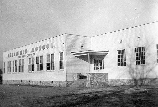 In the early 1950s an addition was built onto the WWII building. This construction added three classrooms, a Principal's office, reception and teachers' offices and indoor restrooms. When this building burned, the county constructed a new brick building which opened September 1963.