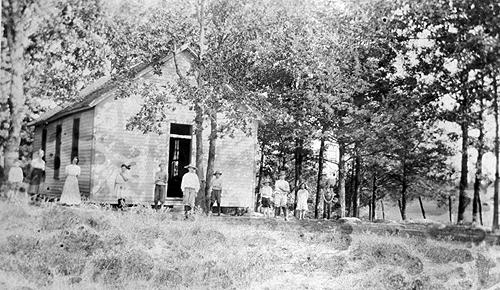 """In 1924, the schoolhouse was improved by adding 24 books to the Library, varnishing a book case, table and chair, and making a rock doorstep """"when the wooden one fell down."""" (Courtesy of Library Special Collections, WKU)"""