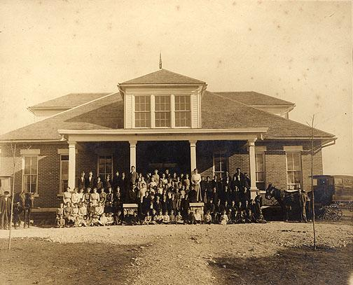 Along with Boyce and Woodburn, Rich Pond was one of the first consolidated schools in Warren County. The district raised $1,750 to contribute towards the $5,250 building. The eight-room building shown here was constructed in 1915. After it burned in 1925, a new building was constructed and opened the following year. Note the mule-drawn wagons used to transport students. (Courtesy of Library Special Collections, WKU)