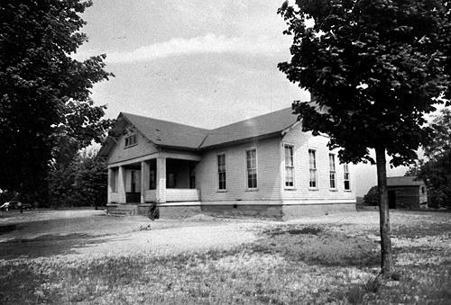 In 1919, the people of Riverside asked the county school board to give them a nine-month school year to add two years of high school work to the curriculum. By 1932-33 Riverside had become a three-year high school. The new two-room, 1925 Riverside School was naurally lit and had a small box stage. (Courtesy of Library Special Collections, WKU)