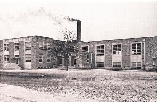 The school's three-story, 15 classroom addition (left), made of Alabama stone was designed by architect J.M. Ingram. Students move into the new addition on February 23, 1948. The frame schoolhouse was sold at auction and replaced with the gymnasium (right) shown in this photograph.(Courtesy of Library Special Collections, WKU)
