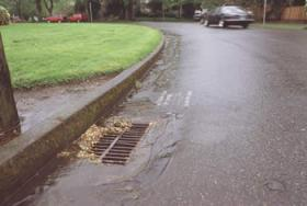 stormwater running in to street drain