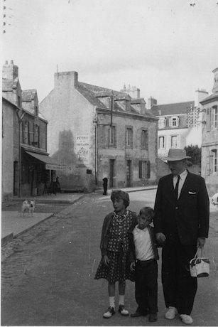 Robert Penn Warren and his children, Rosanna and Gabriel Warren, in Locmariaquer, France, 1961.