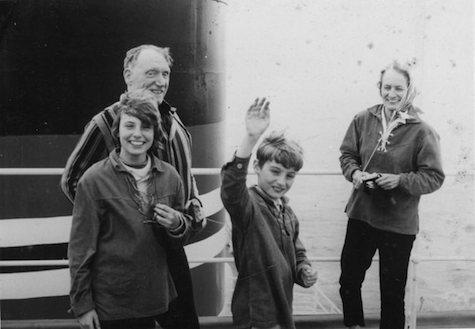 Robert Penn Warren and his wife, Eleanor Clark Warren, with their children, Rosanna Warren and Gabriel Warren, flying a kite from the front of a freighter, 1966.