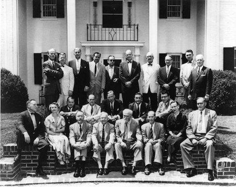 Photo of poets and critics attending the Fugitives reunion at the home of Jesse Ely Wells in Nashville, Tennessee, 1956. First Row: Robert Penn Warren, Dorothy Bethurum (Loomis), Merrill Moore, John Crowe Ransom, Sidney M. Hirsch, Donald Davidson, Louise Cowan, William Yandell Elliott.