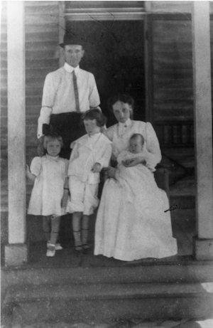 The Warren family on their front porch in Guthrie, Kentucky, 1910. Robert Penn Warren is pictured with his mother, Anna Ruth Penn, his father, Robert Franklin Warren, his sister, Mary Cecilia, and his brother, William Thomas Warren.