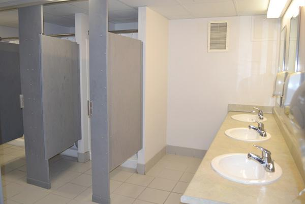Community bathroom style. All toilet and shower stalls lock and showers have a locked private changing area.