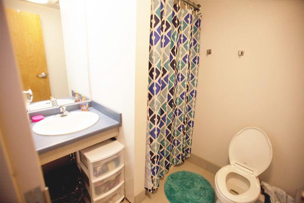 Rooms are set up hotel style with two roommates sharing one private bathroom.