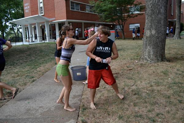 Water balloon fight outside Rodes Harlin Hall