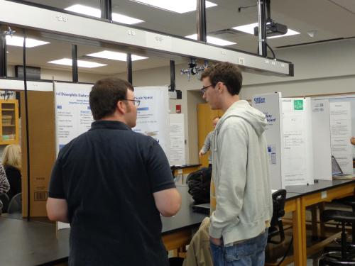 Zachary Bessinger presenting his poster