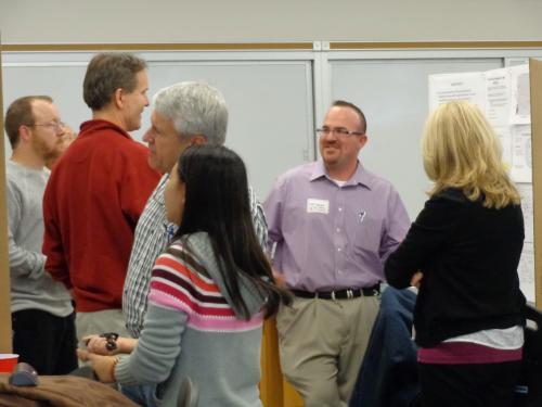 Matthew Bogard (center) presenting his poster