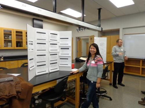 Fang Wu presenting her poster