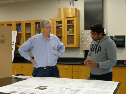 Pavan Kumar Nallaparaju presenting his poster to BISC Co-Director, Dr. Claire Rinehart