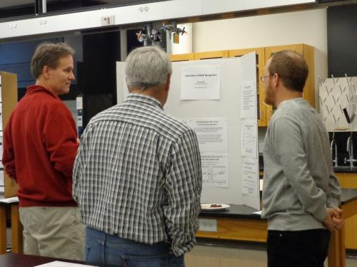 Dr. Lance Hahn (right) presenting his poster