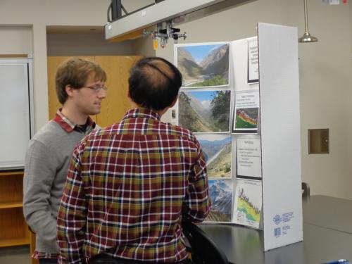 Luke Miles (left) presenting his poster