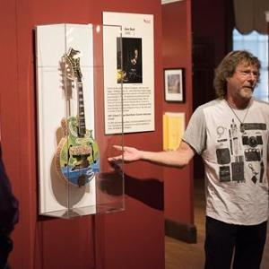 "Sam Bush unveiled his mandolin in the ""Instruments of American Excellence"" exhibit and participated in a narrative stage at the Kentucky Museum. Photos Courtesy of William Kolb."