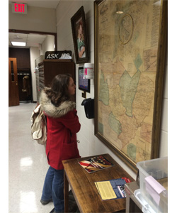 Student looking at 1877 Map of Warren County