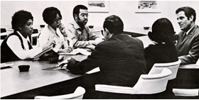 Howard Bailey with unidentified people