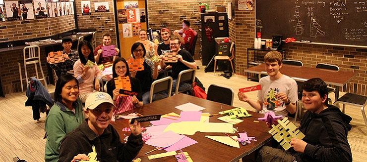 Students participating in Chinese paper cutting.