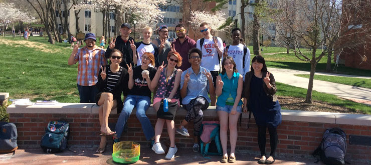 Japanese TA Nana Okada (front right) and her class enjoy the cherry blossoms on the WKU campus.