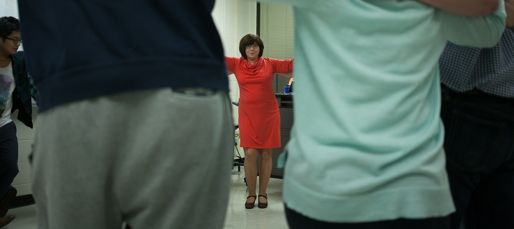 Russian instructor, Ekaterina Myakshina, teaching a Russian dance to students participating in Russian Day festivities.